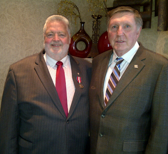 Harry McWatters poses with Bill Barisoff, British Columbia's Speaker of the House, after the pinning of his Queen's Diamond Jubilee Medal on Dec. 14, 2012.