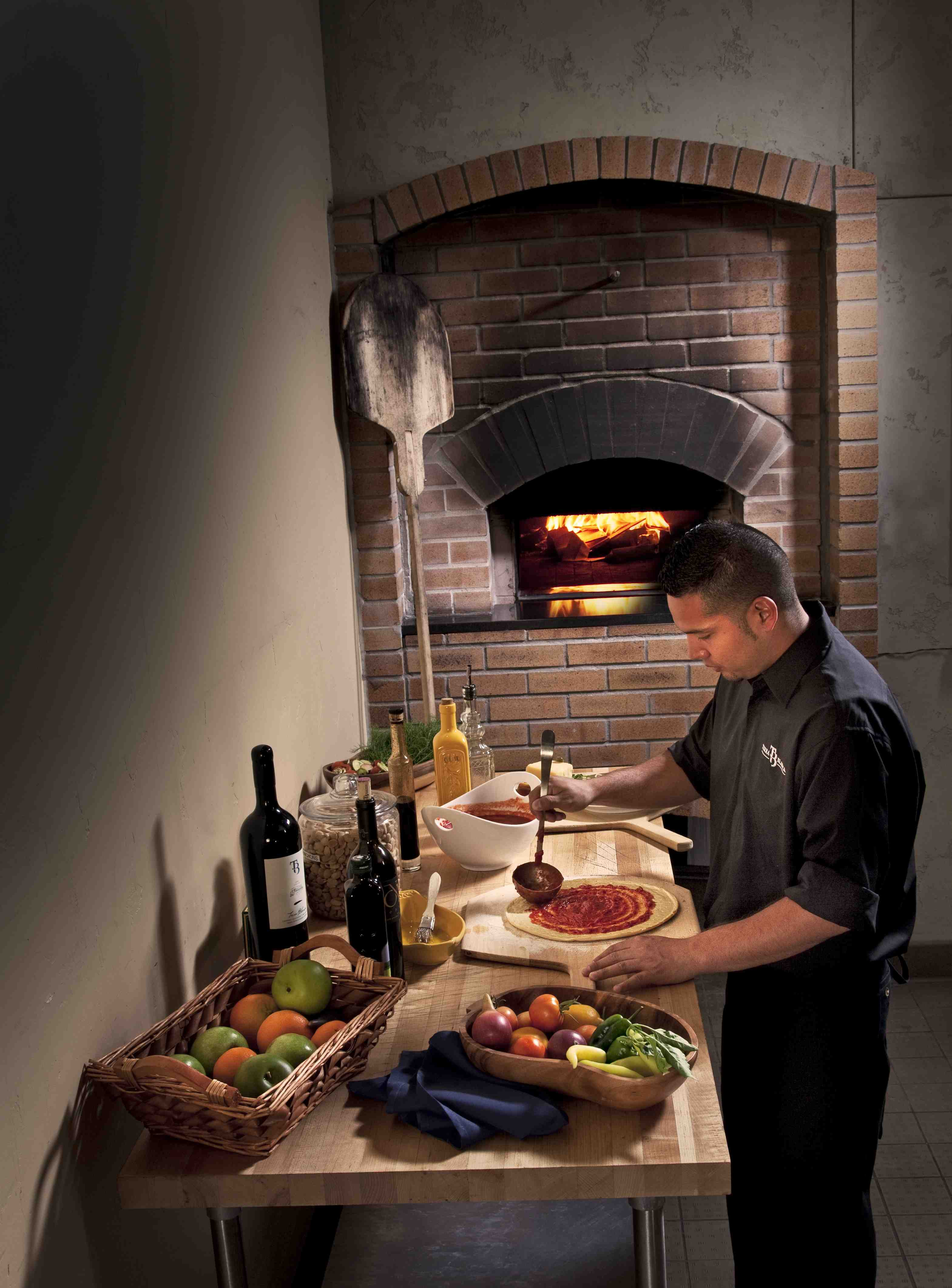 The wood-fired oven is a focal point of Cafe Orsa at Terra Blanca Winery.