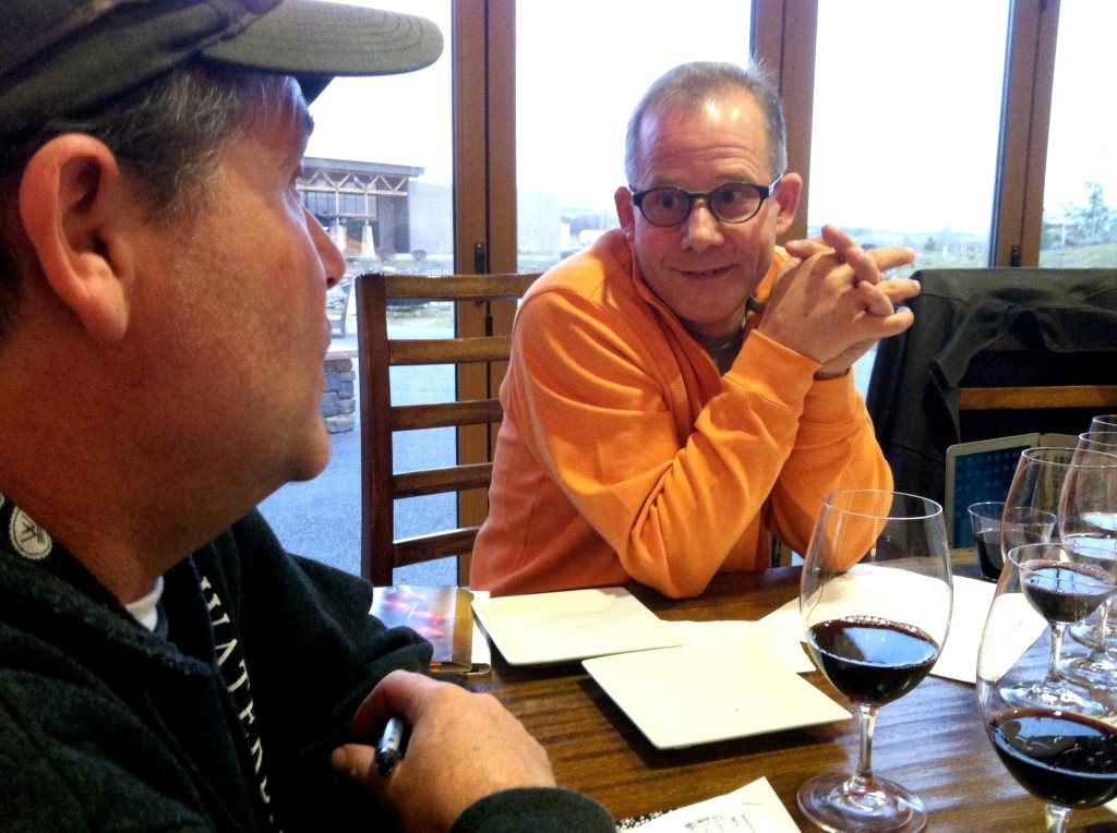 Eric Rindal, founding winemaker and former owner of Waterbrook Winery, chats with current winemaker John Freeman during a library tasting Feb. 6, 2013, in Walla Walla, Wash.