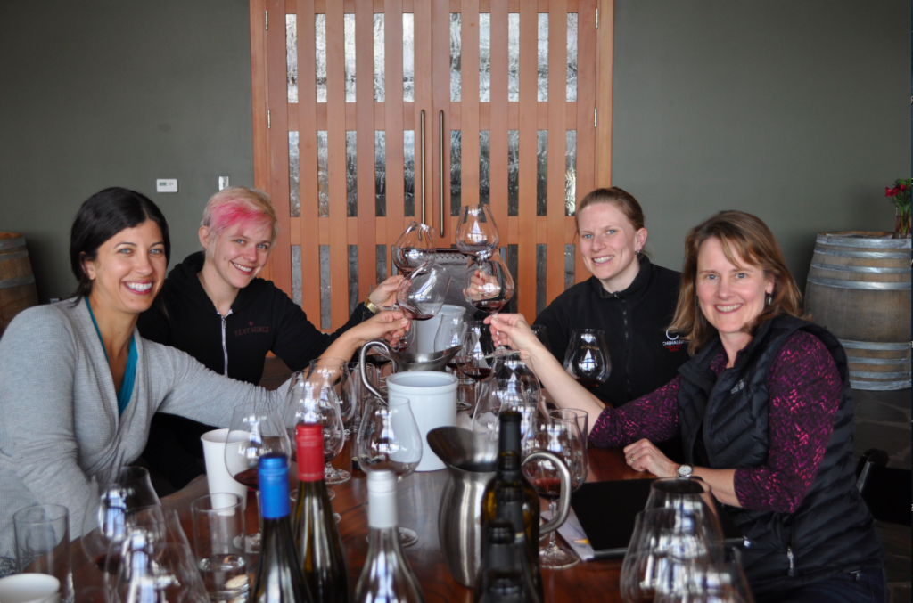 Melissa Burr, Remy Drabkin, Wynne Peterson-Nedry and Lynn Penner-Ash raise a toast during their tasting March 18, 2013 at Penner-Ash Wine Cellars in Newberg, Ore. (Photo courtesy of Katie Bray/Watershed Communications)