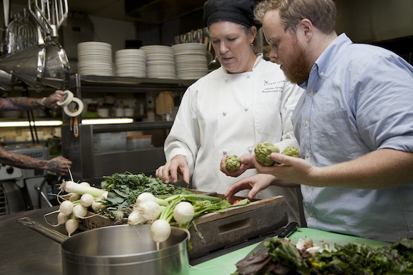 Cafe Flora owner Nat Stratton-Clarke, right, sources sustainable ingredients for executive chef Janine Doran at the Seattle vegetarian restaurant. (Photo courtesy of Café Flora)