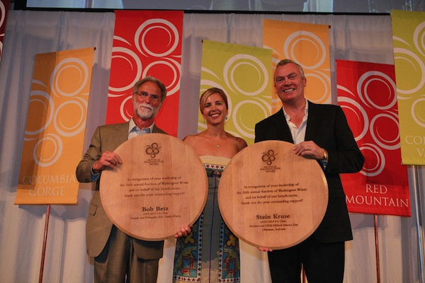 Executive director Sherri Swingle presents co-chairs Bob Betz, left, and Stein Kruse with awards during the 2013 Auction of Washington Wines, held at Chateau Ste. Michelle in Woodinville, Wash. More than $2 million was raised for Children's Hospital and the Washington State University's viticulture and enology program.
