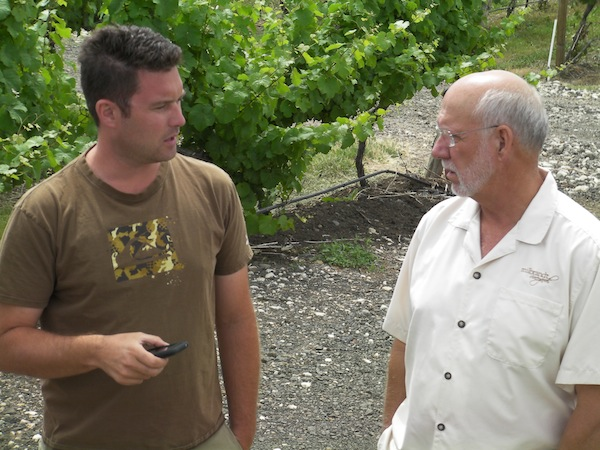 Ryan Flanagan, left, manages Evergreen Vineyard and works for the Milbrandt brothers. Evergreen is owned by Jerry Milbrandt, whose brother Butch is at right.