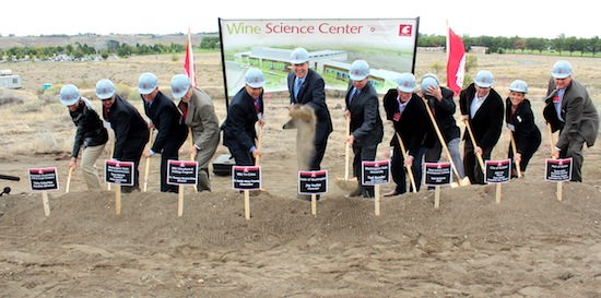 Gov. Jay Inslee is the first to break ground Thursday on the Wine Science Center at Washington State University Tri-Cities' campus in Richland.