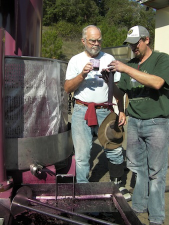 Abacela owner/founding winemaker Earl Jones, left, and his winemaker Andrew Wenzl, press juice for the 2013 Port-style dessert wine in Roseburg, Ore.