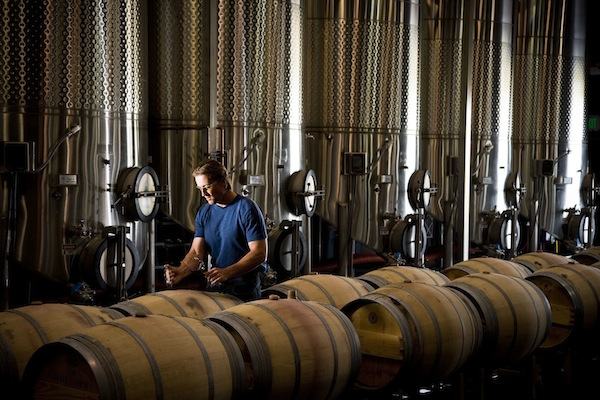 Northstar winemaker David Merfeld samples from barrels at Ste. Michelle Wine Estates' Merlot-focused winery in Walla Walla, Wash.