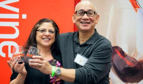 Jamie Peha runs the Seattle Wine & Food Experience. She shares a toast with Wilfred Wong of BevMo.