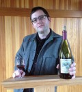 Chris Primus, winemaker for San Juan Vineyards, holds a bottle of the 2009 Estate Pinot Noir, the only time the wine was produced in the winery's 15-year history.