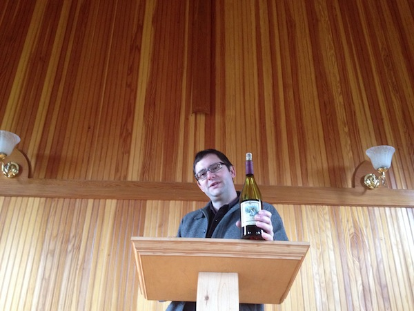 Chris Primus, winemaker for San Juan Vineyards, stands at the pulpit inside the chapel at the Friday Harbor, Wash., winery.