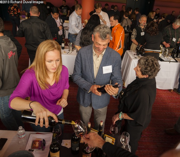 Spring Valley Vineyard winemaker Serge Laville, center, smiles as his wines are being poured at the 2013 Walla Walla Wine at McCaw Hall in Seattle.