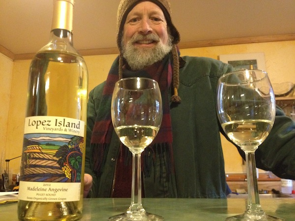 Brent Charnley of Lopez Island Vineyards & Winery, who graduated from University of California-Davis more then 30 years ago, pours his organically grown Madeleine Angevine and other wines on Lopez Island and the Ballard Farmers Market. (Photo by Eric Degerman/Great Northwest Wine)
