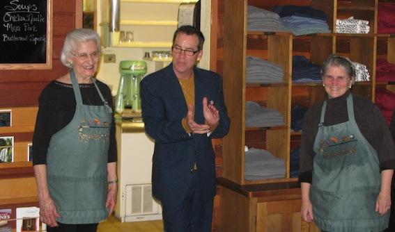Stephen Reustle of Reustle Prayer Rock Vineyards in Roseburg, Ore., applauds the work of Steamboat Inn owners Sharon Van Loan, left, and Patricia Lee.