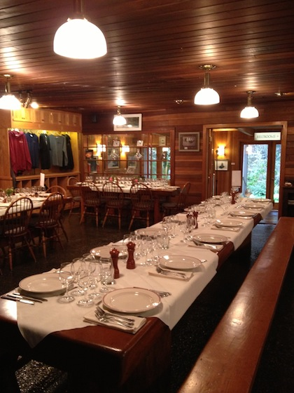 The dining room tables at the Steamboat Inn are set in preparation for a Guest Chef and Winemaker Dinner featuring the wines of Woodward Canyon.