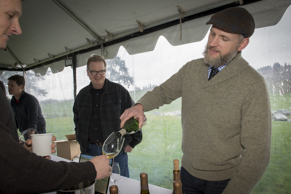 Jason Lett of The Eyrie Vineyards pours during the grand tasting of the third annual Oregon Chardonnay Symposium on March 8, 2014 at Stoller Family Estate in Dayton.