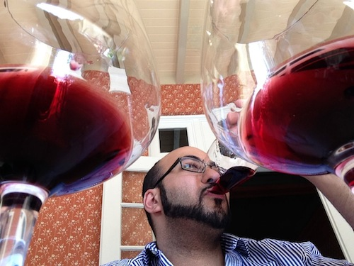 Yashar Shayan, owner of ImpulseWine.com in Seattle, tasted through red wines at the second annual Great Northwest Wine Competition in Hood River, Ore.