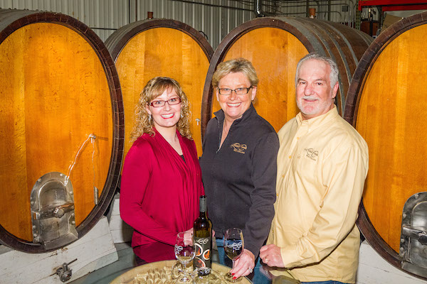 Natalie Conway-Barnes, left, her mother, Ellena Conway, center, and father Mike Conway all have recipes featured in re-issued cookbook by Latah Creek Wine Cellars'.