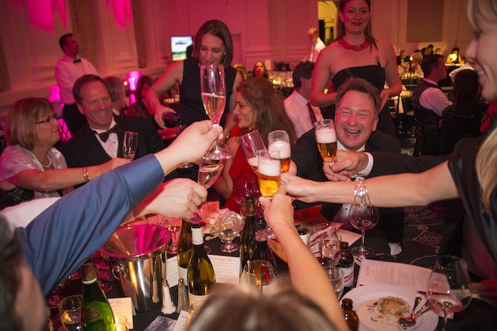 Dundee winemaker Joe Dobbes joins dinner guests for a toast during the annual Oregon Wine Auction.