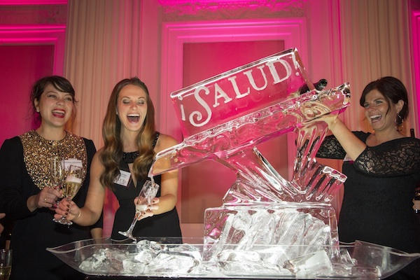Emily Bachand of Stoller Family Estate pours sparkling wine through an ice sculpture during the 2013 ¡Salud! Oregon Pinot Noir Gala Dinner Auction.