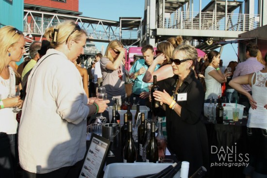 Kathleen Shoup of Long Shadows Vintners pours for the Walla Walla winery on Pier 66 as part of Wine Rocks Seattle. (Photo by Dani Weiss Photography/Courtesy of Wine Rocks Seattle)