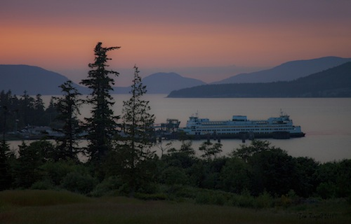 The beautiful San Juan Islands rise above the Anacortes ferry. (Photo by Tom Ringold/via Flickr)
