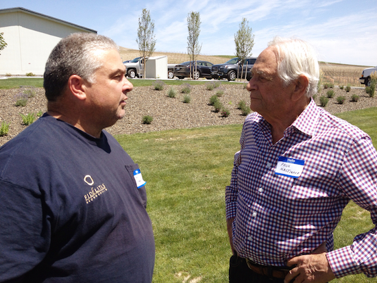 Charlie Hoppes, left, of Fidelitas Wines and Wine Boss in Richland, Wash., chats with Quintessence Vineyards co-owner Paul Kaltinick on Red Mountain.