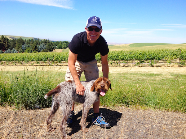 Chris Figgins and Tank, his young wirehaired pointing griffon, lead a group of visitors to the Mill Creek region of the Walla Walla Valley on Thursday, June 19, 2014.