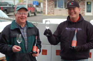 John Bradley, left, and Terry Brandborg toast the first commercial bottling of wine — Riesling harvested in 2012 — from the newly established Elkton American Viticultural Area. Brandborg used Bradley Vineyard fruit for the historic wine.