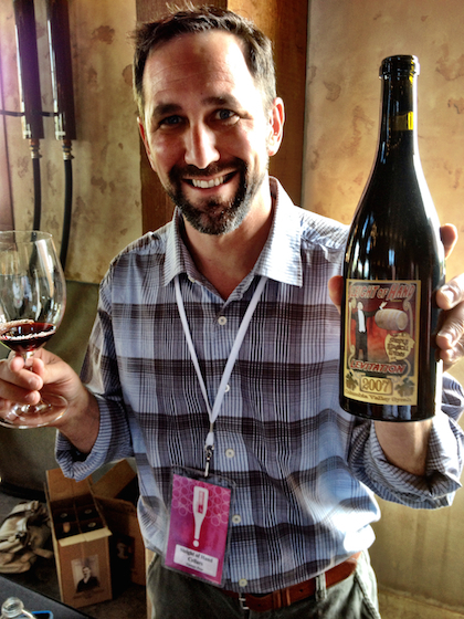 Trey Busch of Sleight of Hand Cellars pours at Garrison Creek Cellars in Walla Walla, Wash., during Vintage Pour of the Celebrate Walla Walla Valley Wine — The World of Syrah on Thursday, June 19, 2014.