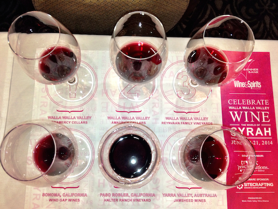 Samples from six bottlings of Syrah from throughout the world are presented at the start of the winemaker panel portion of Celebrate Walla Walla Valley Wine — The World of Syrah on Thursday, June 19, 2014.