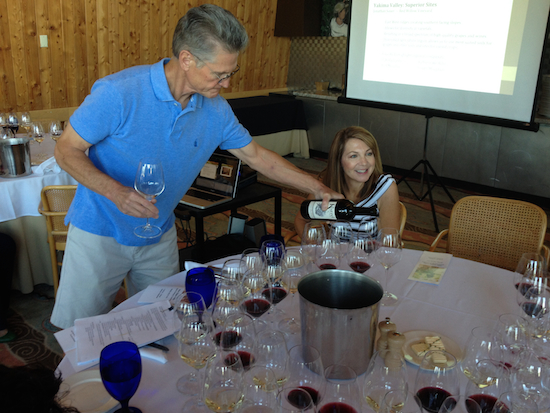 Wade Wolfe, co-owner and winemaker of Thurston Wolfe Winery in Prosser, Wash., pours samples for Barbara Glover, executive director for Wine Yakima Valley.