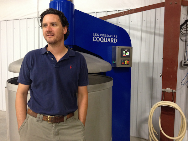 Kyle Johnson enjoys his first crush in the new production facility for Purple Star and Native Sun wines in Benton City, Wash.