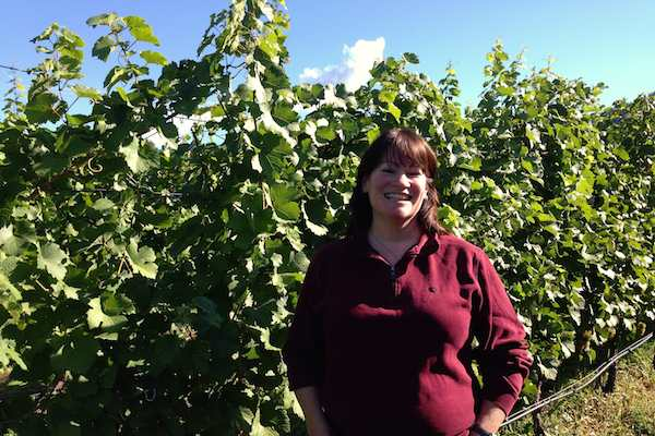 Mary McDermott, standing in front of Gewurztraminer vines, is in her first crush as winemaker of Township 7 Vineyards and Winery in Penticton, British Columbia.