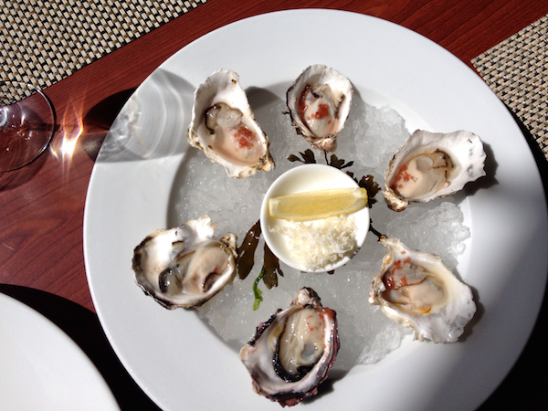 Fresh oysters from the Pacific Ocean are served on the half shell in the Old Vines Restaurant at Quails' Gate Estate Winery in West Kelowna, British Columbia.