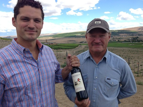 Brian Rudin and Dick Boushey hold a bottle of Canvasback 2012 Cabernet Sauvignon from Red Mountain grapes.
