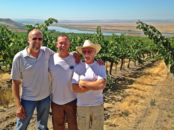 Sagemoor Vineyards general manager Kent Waliser, Long Shadows director of winemaking Gilles Nicault and Napa Valley winemaker Randy Dunn inspect Cabernet Sauvignon at Sagemoor Vineyards along the Columbia River north of Pasco, Wash.