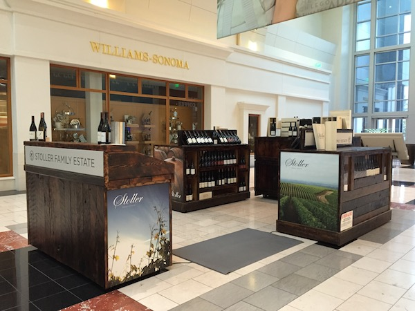 Stoller Family Estate in Dayton, Ore., opens its kiosk Nov. 1, 2014 at Washington Square, becoming the first winery to pour and sell wine in the shopping center's history.