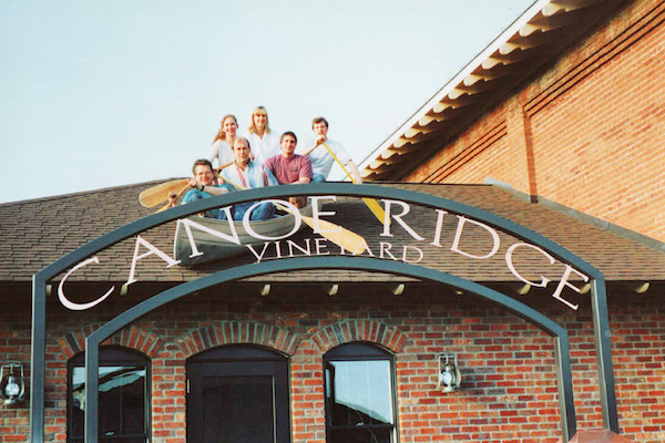 Founding winemaker John Abbott (wearing a red shirt) and friends pose for a candid photo atop Canoe Ridge Vineyard tasting room in Walla Walla, Wash. Abbott made the wine from 1993 until 2002, when he launched Abeja in the Walla Walla Valley.