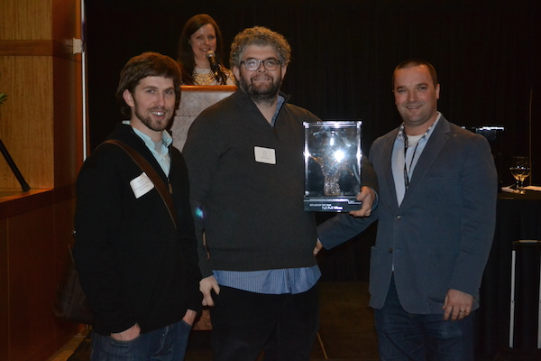 Paul Zitarelli, center, and Matt Tessler of Full Pull Wine in Seattle receive the Retailer of the Year goblet from Chris Stone and the Washington State Wine Commission on Jan. 27, 2015, in Seattle.