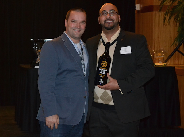 Yashar Shayan of ImpulseWine.com receives the Independent Retailer of the Year from Chris Stone and the Washington State Wine Commission on Jan. 27, 2015, in Seattle.