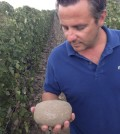 """christophe looks at rock feature 120x134 - Cayuse Vineyards won't use new """"Rocks District"""" on its label"""