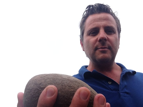 Christophe Baron of Cayuse Vineyards holds a cobblestone from his vineyard in the Walla Walla Valley.
