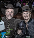Yakima Valley winemaker Gordie Hill and Walla Walla vintner/grower Lynne Chamberlain raise a toast during the Washington Association of Wine Grape Growers' Unity Banquet in Kennewick, Wash.
