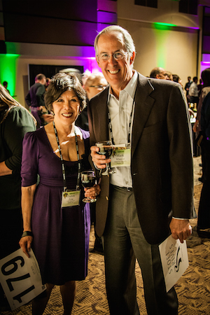 Seattle's Judith Fong of FW Wine LLC and Mark Wheeler of StoneTree Vineyard prepare to bid in the Angel Share Auction at the Washington Association of Wine Grape Growers.