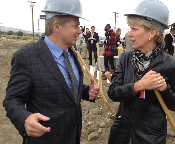 Vicky Scharlau, executive director of the Washington Association of Wine Grape Growers, chats with Ted Baseler, CEO of Ste. Michelle Wine Estates, on Sept. 26, 2013, after the groundbreaking for Washington State University's Wine Science Center in Richland.