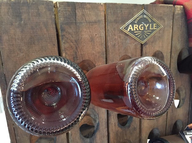 An antique Argyle Winery riddling rack is on display in the historic tasting room in Dundee, Ore.
