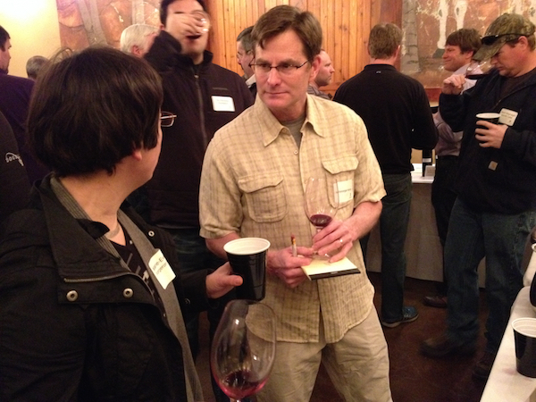 Chuck Reininger, founding winemaker of Reininger Winery in Walla Walla, chats with Forgeron Cellars winemaker Marie-Eve Gilla on Feb. 27, 2015, while sampling Syrah made from the 2014 vintage off Seven Hills Vineyard. The 10th annual tasting was held at L'Ecole No. 41 in Lowden, Wash.