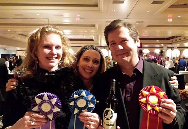 Loree Spangler, left, Laura Jones of Dino's Ristorante in Roseburg, Ore., and Patrick Spangler display the ribbons that came with each of their People's Choice awards at the 2015 Greatest of the Grape in Canyonville, Ore.