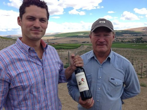 Brian Rudin and Dick Boushey hold a bottle of Canvasback 2012 Cabernet Sauvignon on Red Mountain.