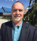 Greg Jones serves both as director of business, communication and the environment at Southern Oregon University in Ashland, as well as professor of environmental science and policy.