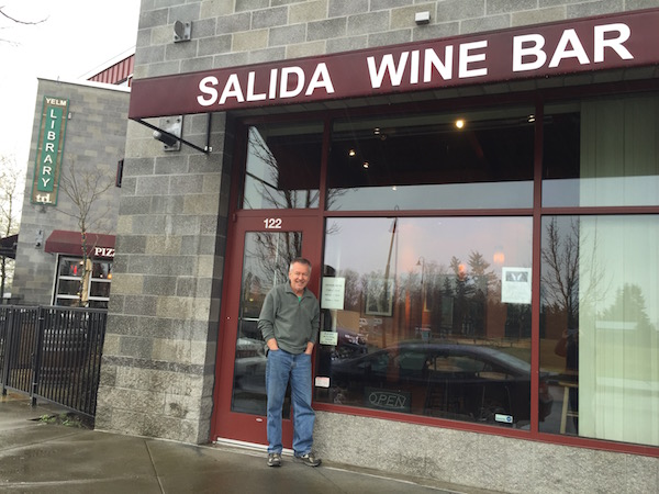 Doug McCrea stands outside his Salida Wine Bar, which is around the corner from the library in downtown Yelm, Wash.